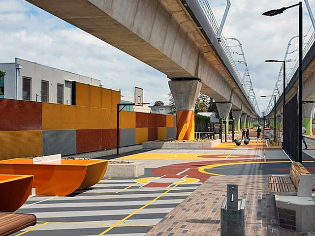 Table tennis provided as part of a new public plaza space by ASPECT Studios beneath an elevated rail. Peter Bennetts Photography.